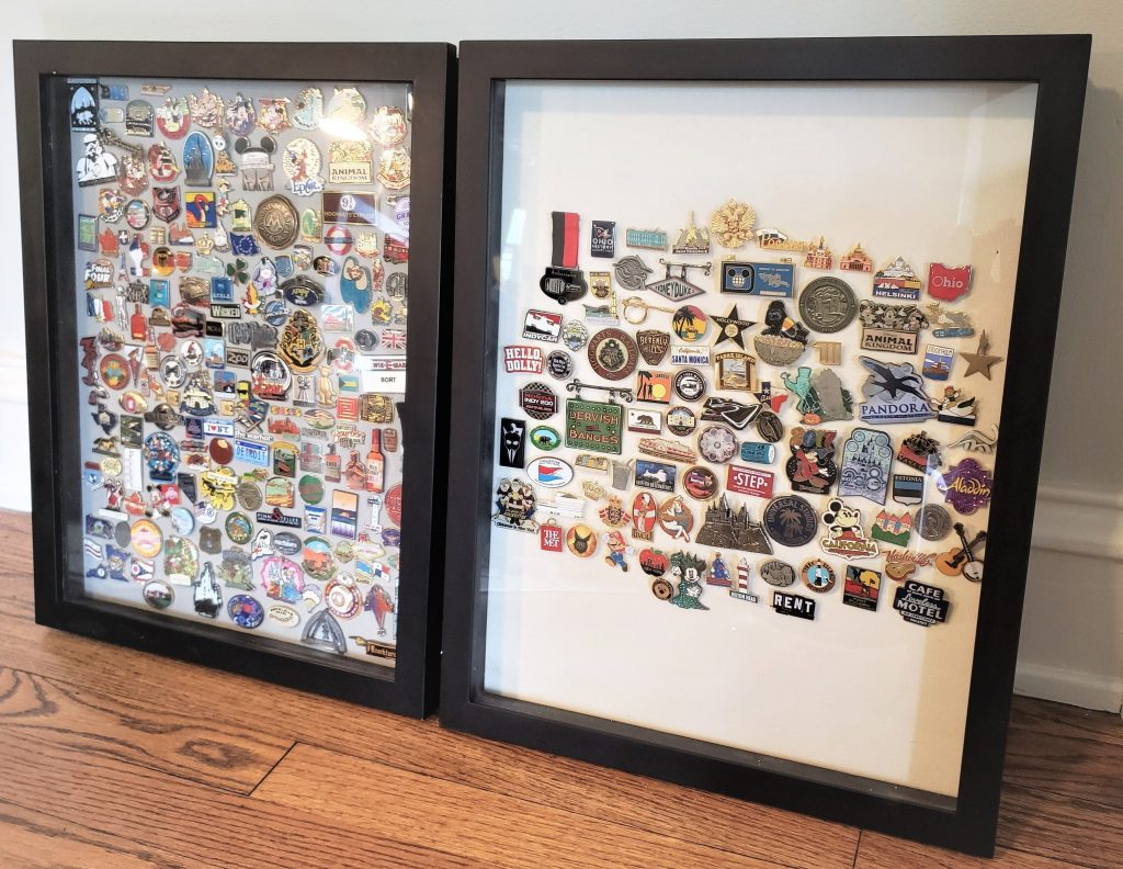 The shadow boxes housing our pin collection to date