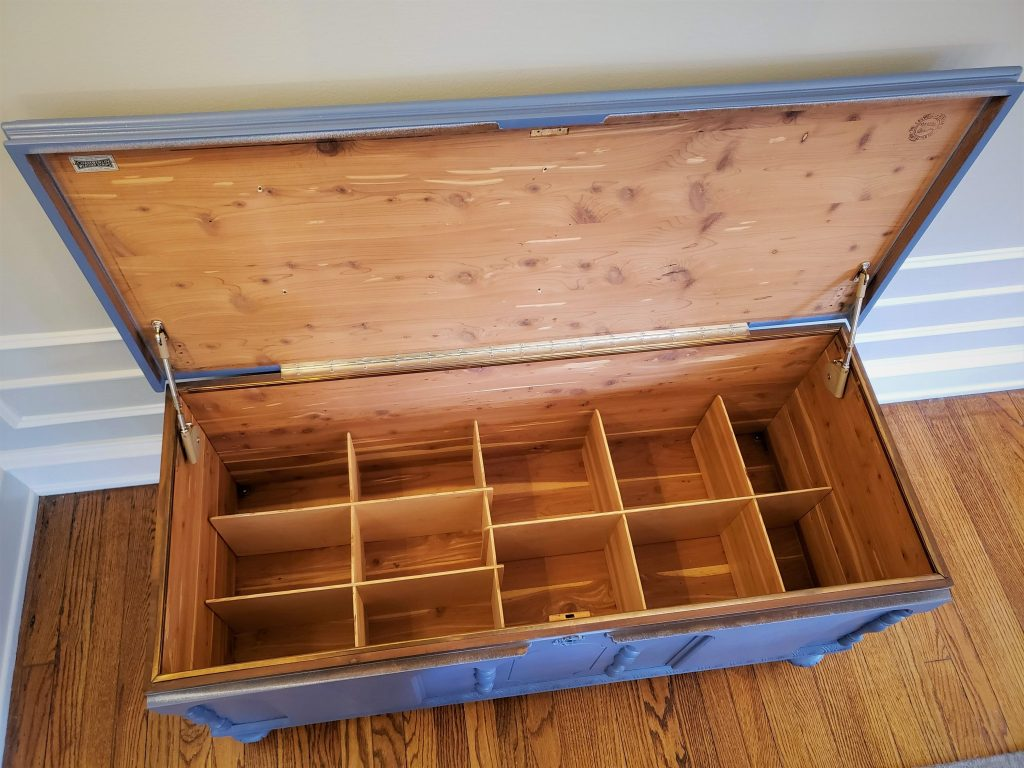 The inside of the cedar chest with inserts