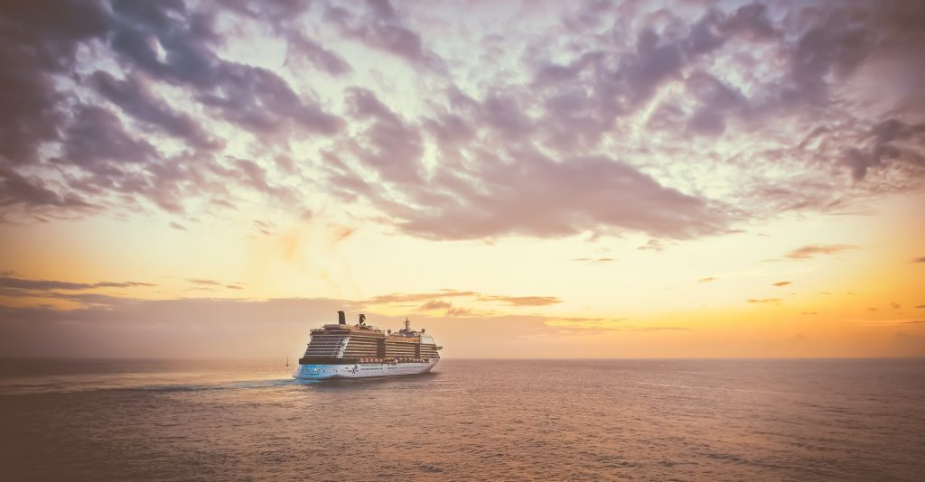 A photo of a cruise ship at sunset