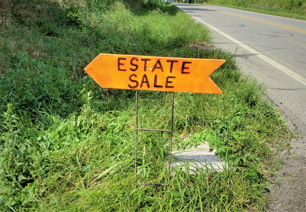 A road-side estate sale sign