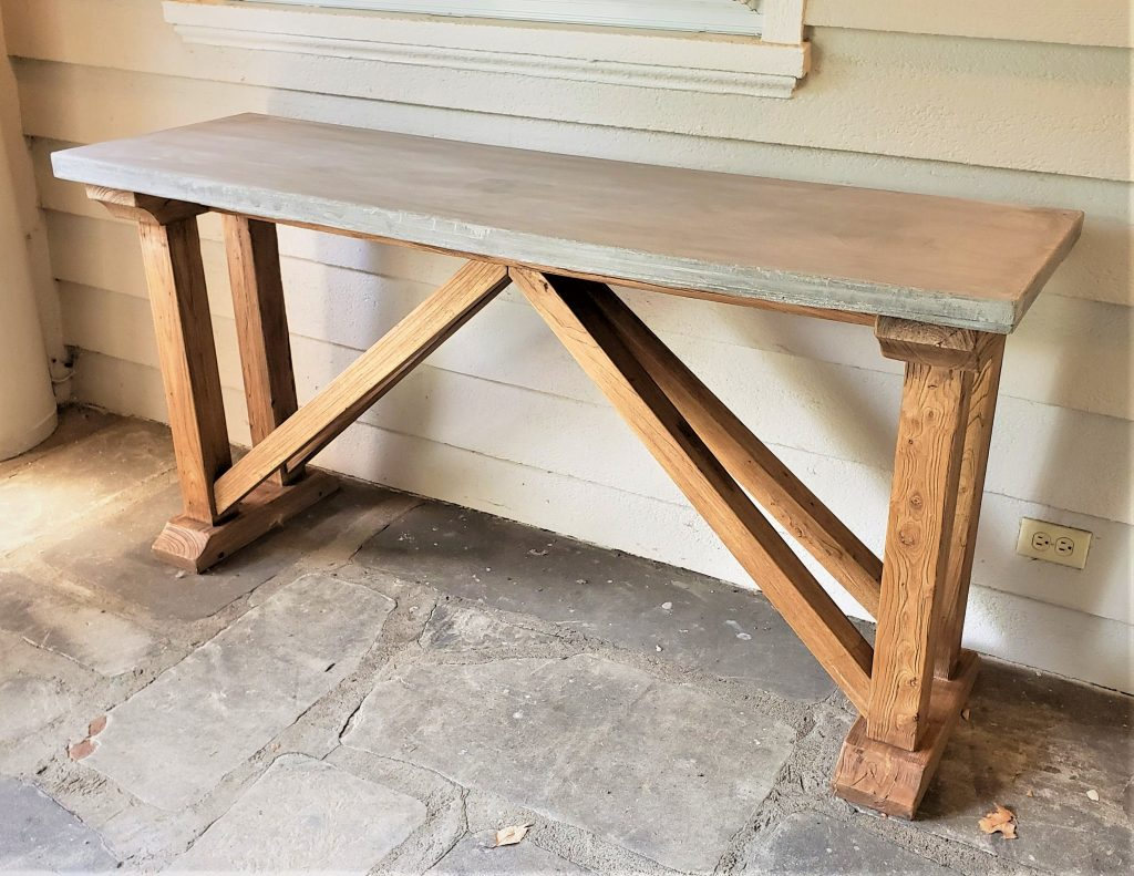 The finished console table with new concrete top
