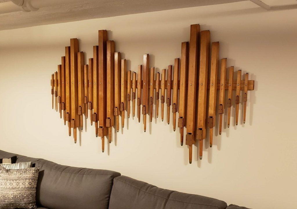 Our finished vintage organ pipe wall art project