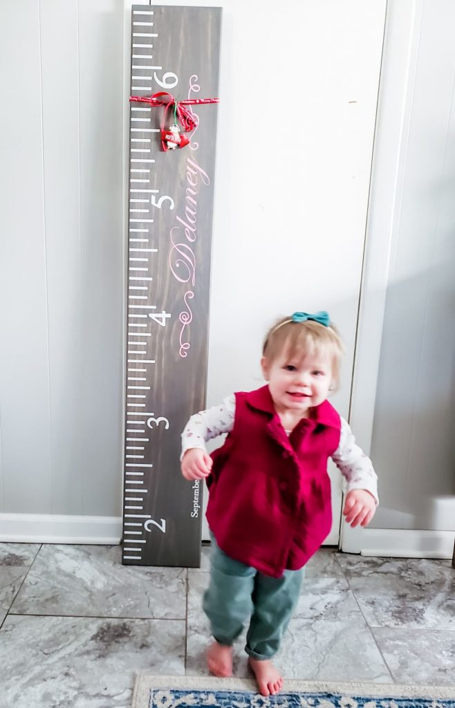 My niece with her new growth chart ruler